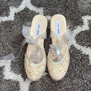 Ballerina wedge shoes.